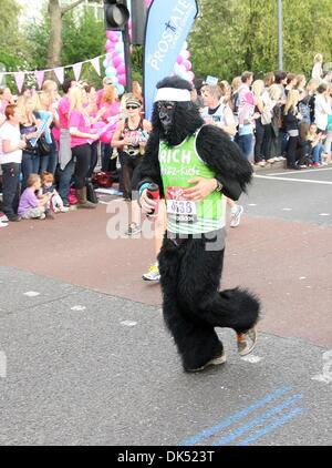 Apr 17, 2011 - London, England, United Kingdom - Runner dressed in a Gorilla outfit during the 2011 London Marathon - Stock Photo