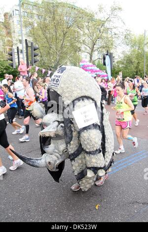Apr 17, 2011 - London, England, United Kingdom - Runner dressed in a rhino outfit during the 2011 London Marathon - Stock Photo