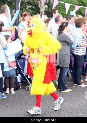Apr 17, 2011 - London, England, United Kingdom - Runner dressed in a chicken outfit during the 2011 London Marathon - Stock Photo