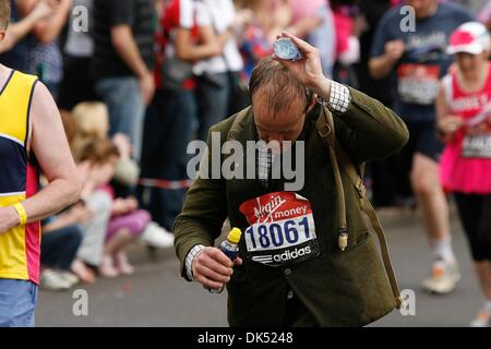 Apr 17, 2011 - London, England, United Kingdom - Runner dressed in a tweed suit cools off during the 2011 London - Stock Photo