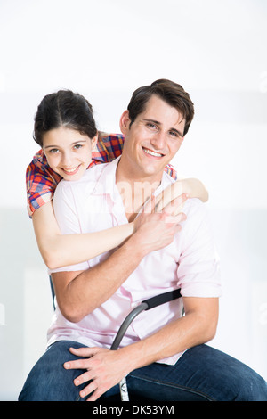 Older brother and younger sister on white background - Stock Photo
