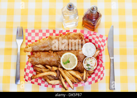 A traditional serving of fish and chips - Stock Photo