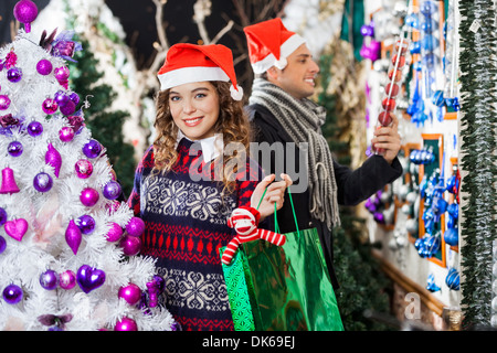 Man And Woman Shopping In Christmas Store - Stock Photo