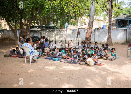 Rural Indian village school teacher and children in an outside class. Andhra Pradesh, India - Stock Photo