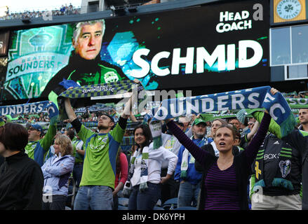 June 11, 2011 - Seattle, Washington, USA - Seattle Sounders FC fans hold up their scarves while their team's head - Stock Photo