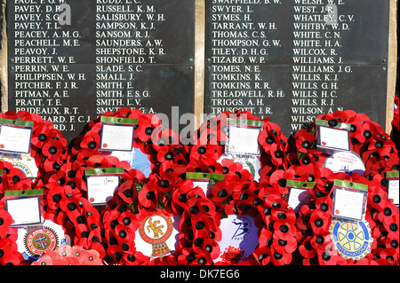 Poppy wreaths and names at a cenotaph during a Remembrance Service, UK - Stock Photo