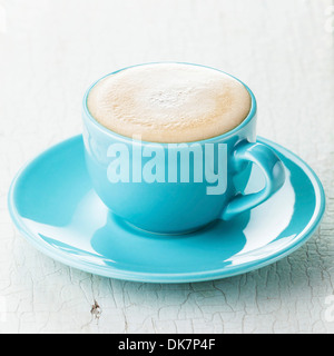 Cappuccino coffee in blue coffee cup - Stock Photo