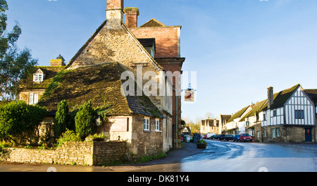 View of the main street through Lacock, a medieval wool merchants' village in Wiltshire. - Stock Photo