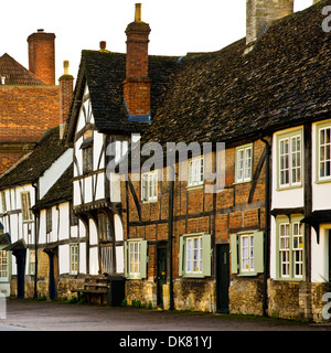 Medieval timber-framed houses, once belonging to wool merchants, in the pretty, historic village of Lacock in Wiltshire. - Stock Photo