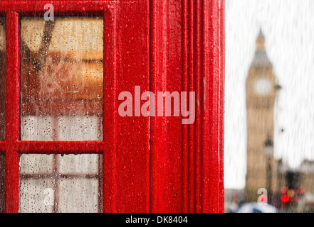 Big ben and red phone cabine in London. Rainy day - Stock Photo
