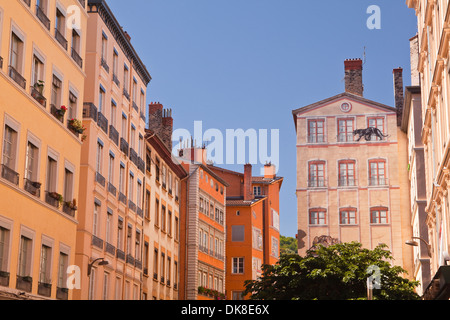 Painted building facades in Vieux Lyon. - Stock Photo