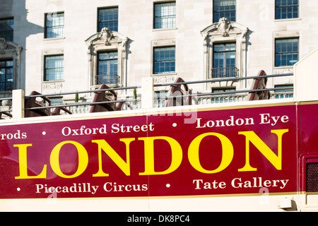London tour bus. Close up top level and building on the background - Stock Photo