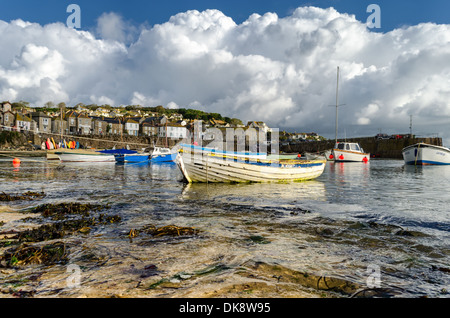 Boats moored in Mousehole Harbor.  Mousehole, Cornwall, England. - Stock Photo