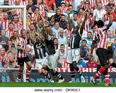 Joey Barton of Newcastle United (2nd L) along with Fabricio Coloccini (C) and Shola Ameobi (R) appeal for a penalty - Stock Photo
