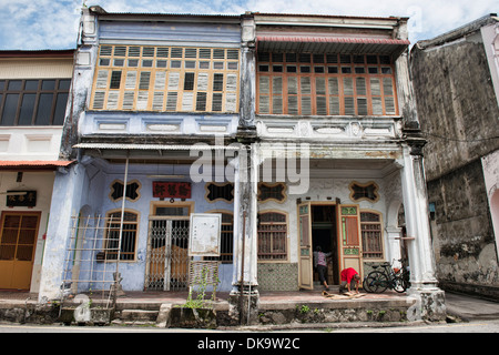 Traditional Chinese shop houses in the UNESCO World Heritage zone of Georgetown in Penang, Malaysia - Stock Photo