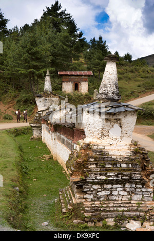 Bhutan, Phobjika, old vandalized village chorten, with wall broken to steal relics - Stock Photo