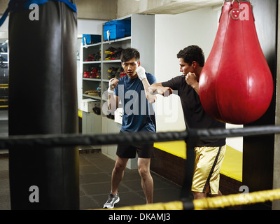 Boxers warming up in changing room - Stock Photo