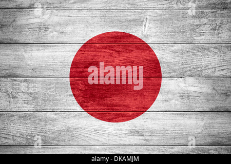 flag of Japan or Japanese banner on wooden background - Stock Photo