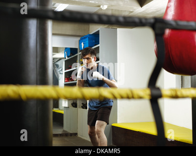 Boxer warming up in changing room - Stock Photo