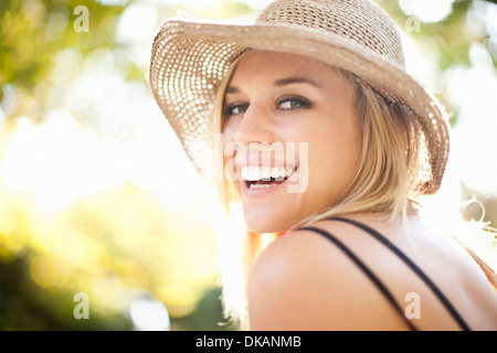 Close up portrait of young woman in park - Stock Photo