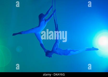Couple on trapeze - Stock Photo