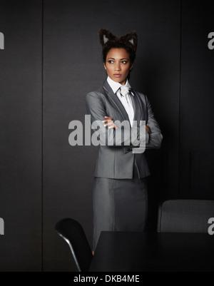 Businesswoman wearing fancy dress ears - Stock Photo