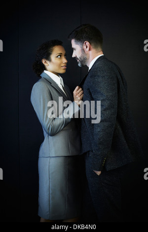 Portrait of couple in business clothing - Stock Photo