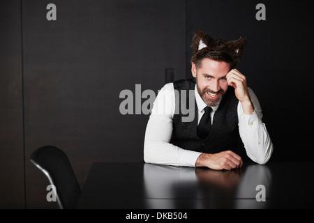 Businessman wearing animal ears