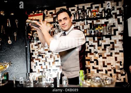 Barman mixing cocktail - Stock Photo