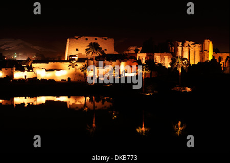 Great Temple of Amun reflections in sacred lake - Karnak Temple sound and light show, Luxor, Egypt - Stock Photo