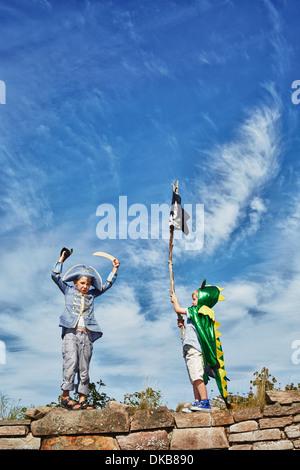 Two boys dressed up, one holding pirate flag, Eggergrund, Sweden - Stock Photo
