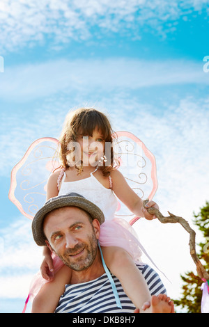 Father carrying daughter on shoulders, Eggergrund, Sweden - Stock Photo
