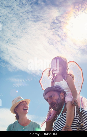 Father carrying daughter on shoulders, mother laughing, Eggergrund, Sweden - Stock Photo