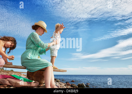 Mother and daughters on beach, Eggergrund, Sweden - Stock Photo