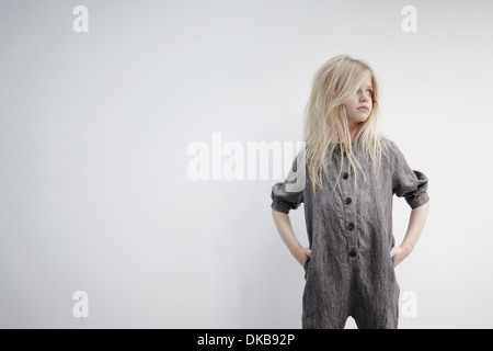 Portrait of girl with hands on hips - Stock Photo
