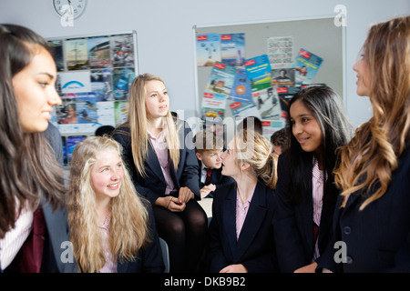 Schoolgirls working on ideas in class - Stock Photo