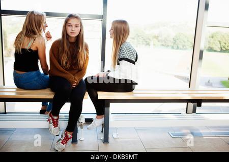 Isolated teenage schoolgirl in corridor - Stock Photo