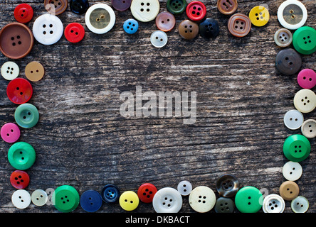 sewing background with frame from buttons - Stock Photo