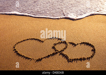 valentines day card, two hearts on the beach - Stock Photo