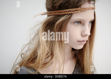 Portrait of girl wearing leather braid around head - Stock Photo