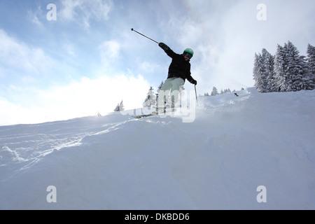Skier going downhill - Stock Photo