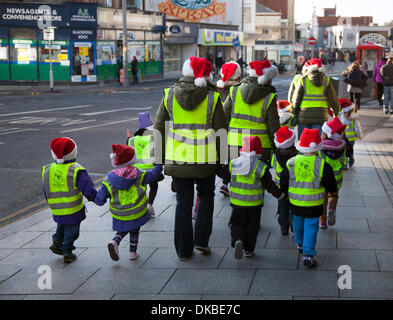Blackpool, Lancashire, UK 4th December, 2013.   Rear view of risk assessed Pre-school children and teachers, safeguarded - Stock Photo