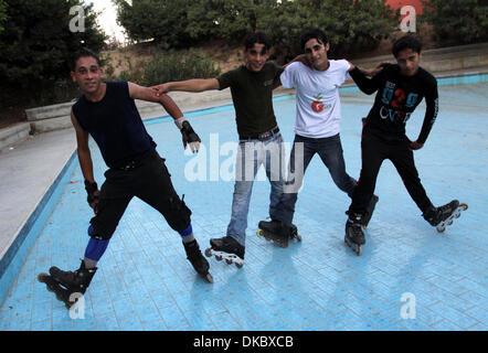 Oct. 10, 2011 - Gaza City, Gaza Strip - Palestinian wheel athletes using Rollerblades or In-line skates demonstrate - Stock Photo