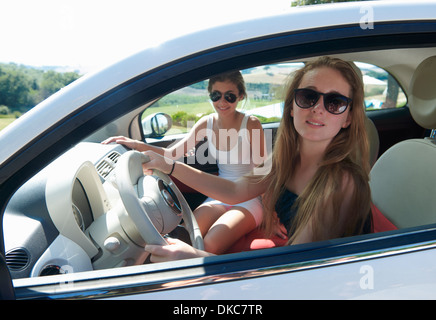 Teenagers sitting in car - Stock Photo