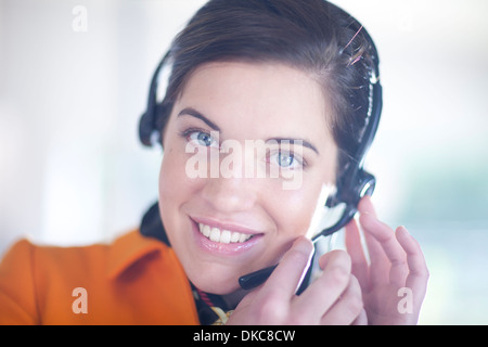 Businesswoman wearing telephone headset - Stock Photo