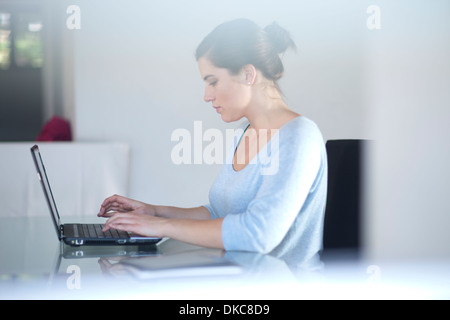 Businesswoman using laptop computer - Stock Photo