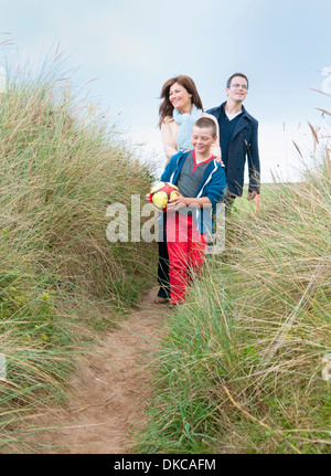 Family walking in sand dunes - Stock Photo