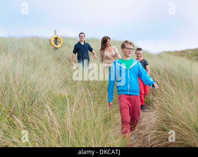Family strolling coastal path - Stock Photo
