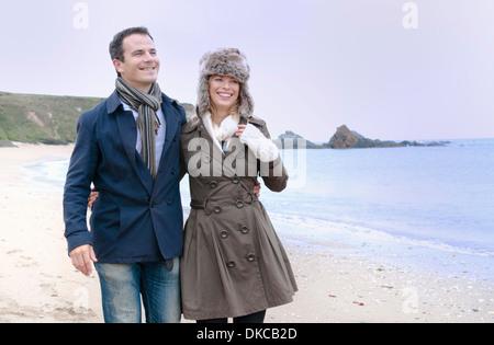 Mid adult couple strolling on beach, Thurlestone, Devon, UK - Stock Photo