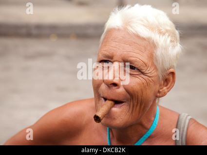 Cuba woman smoking cigar - Old woman smoking a cigar, close up of head and shoulders, Havana, Cuba Caribbean Latin - Stock Photo